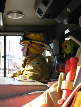 sideview of firefighter in yellow uniform