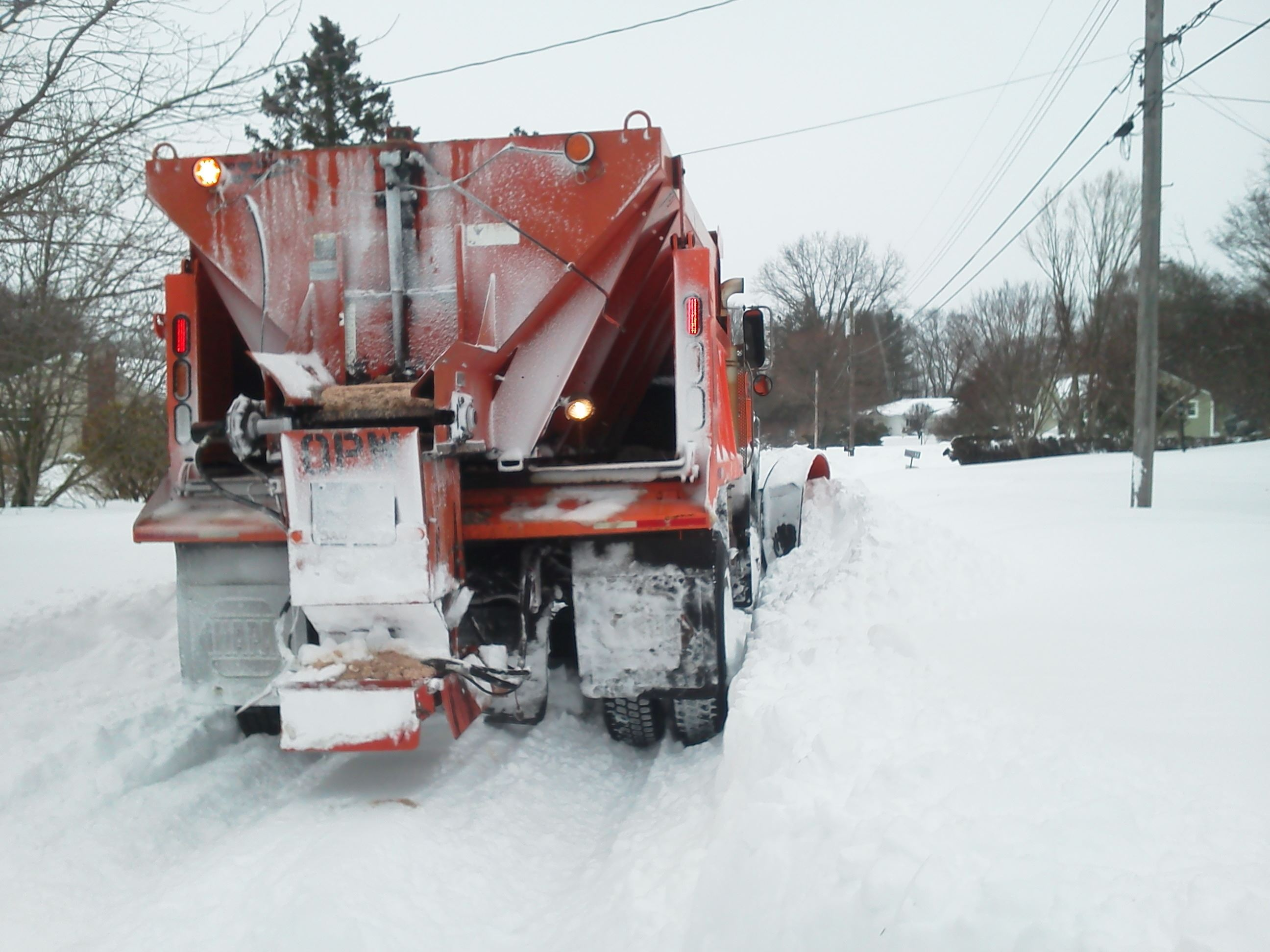 Back of Orange plow truck in snow